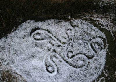 Archaeology-swastika-stone-in-snow-photographer-colin-williams